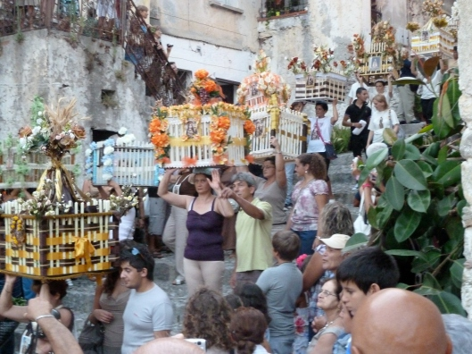 Headress in procession in Scalea