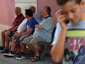 Intergenerational bench sitting.
