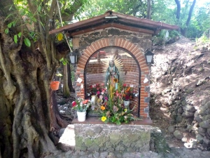 Permanent shrine on a small side street.