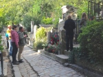 It's fascinating that Chopin's grave is covered with flowers and surrounded by visitors.
