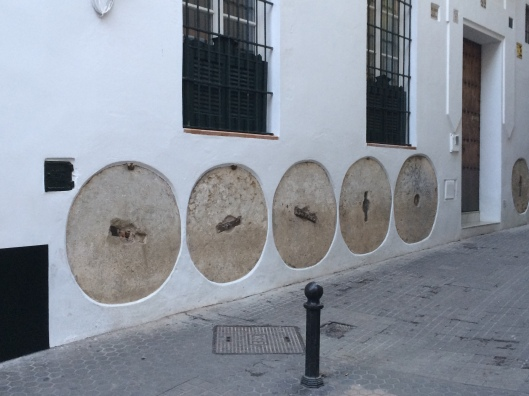 These fascinating millstones are a part of the history of Sevilla and remain in the exteriors of houses.